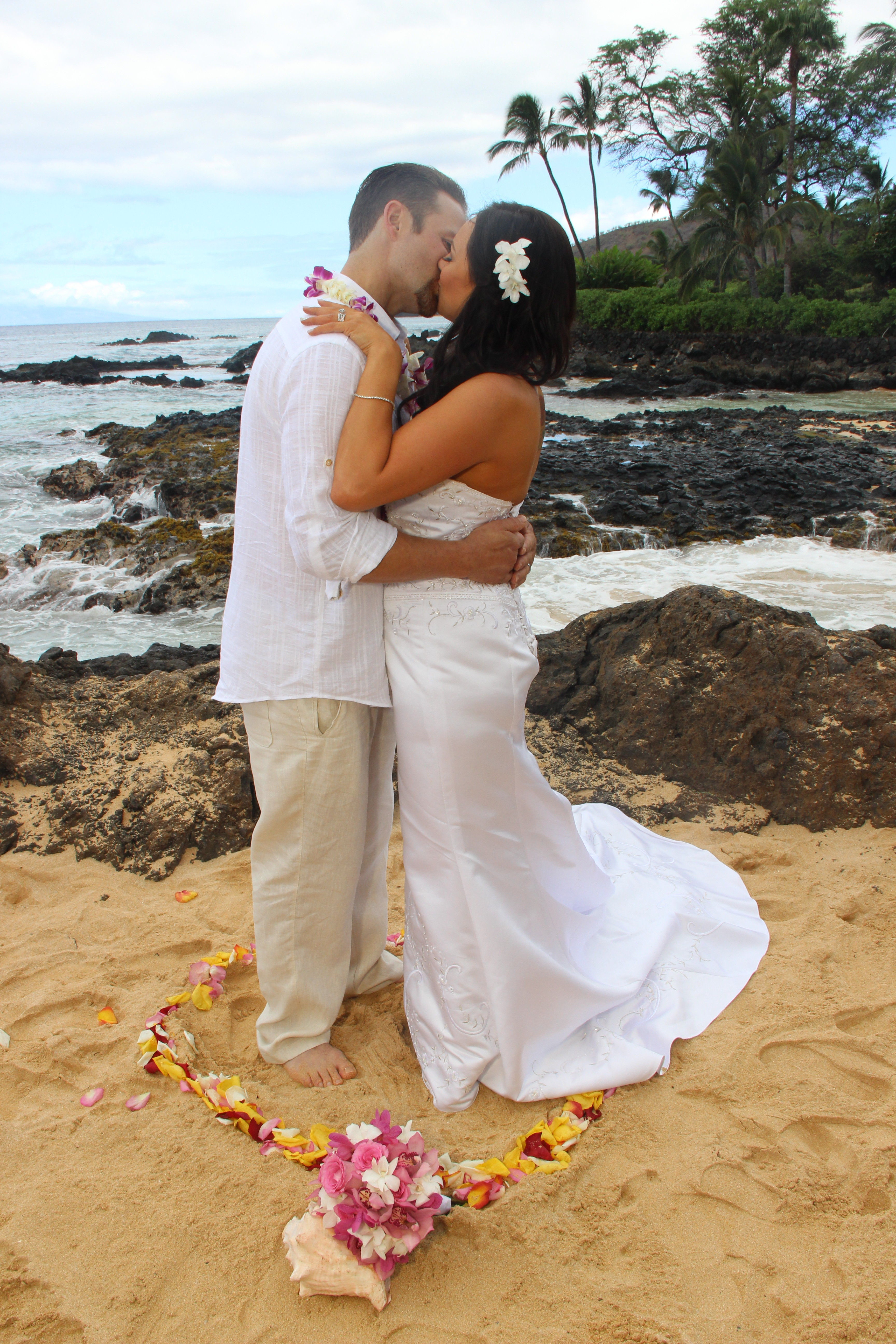 wedding ceremony on maui beach with white orchid hair comb as an